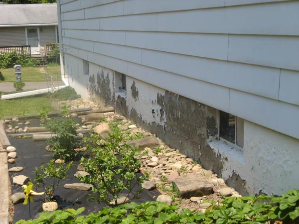 how to get paint off concrete foundation