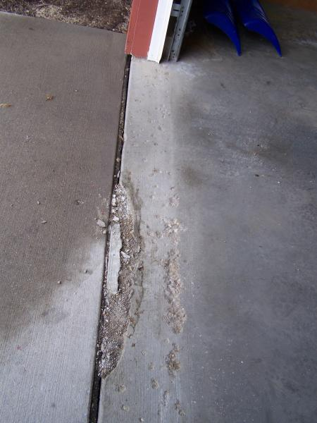Concrete chipping away at front edge of garage floor for Concrete block floor