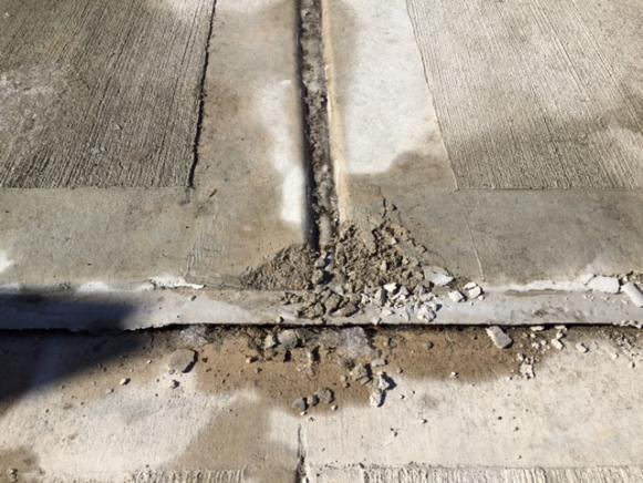 Concrete Sidewalks Do It Yourself : Damage concrete sidewalk and driveway doityourself