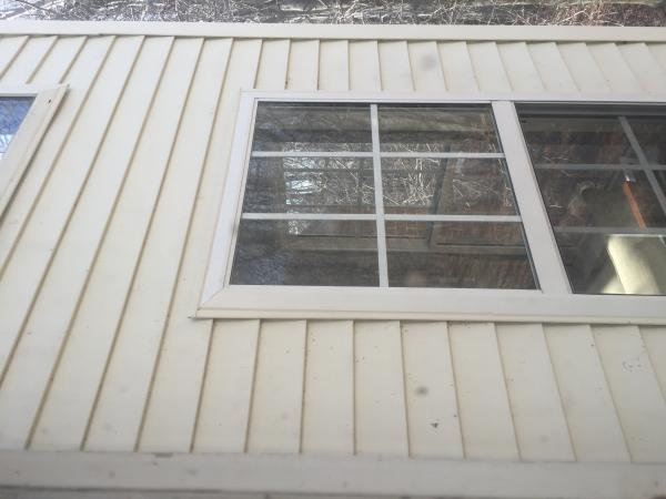 Do I Need To Caulk Behind Doors And Windows Vinyl Siding
