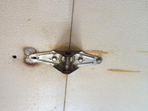 Screws Keep Popping Out Of Garage Door Doityourself Com