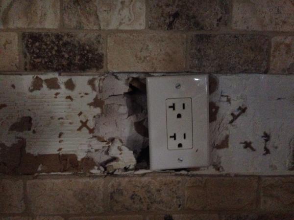 Repair damaged drywall for kitchen backsplash