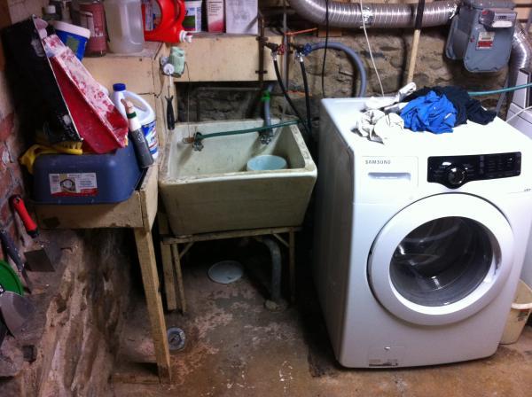 washing machine draining into sink