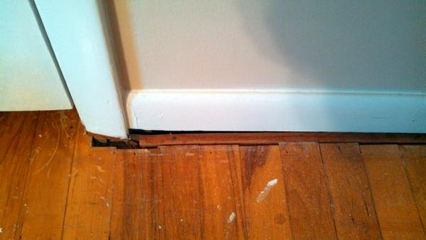 Laid Laminate Flooring There Is A Gap Between The Door
