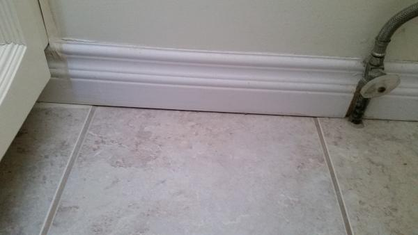 Fill in the crack between the wall and floor of my tiled How to fill a crack in the wall
