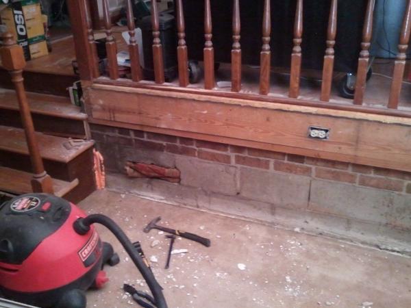 Proper way to finish interior foundation wall on bottom of